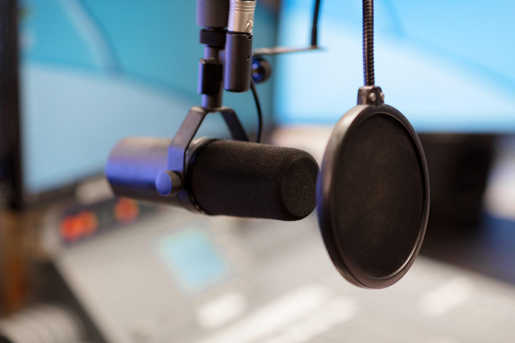 Microphone in modern radio station broadcasting studio